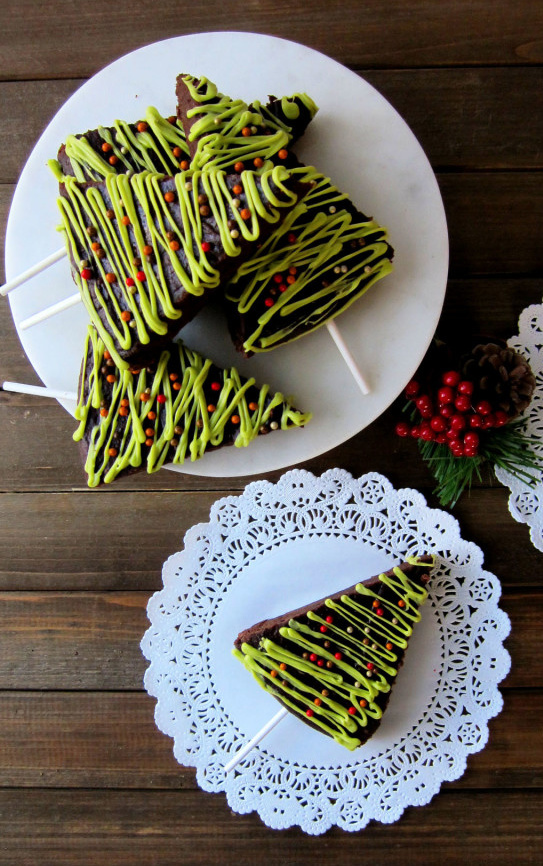 Christmas themed peanut butter brownies stacked on each other.