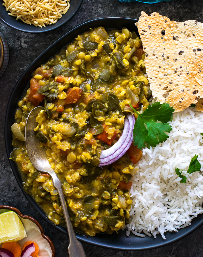 Drumstick leaves dal served with rice and papad