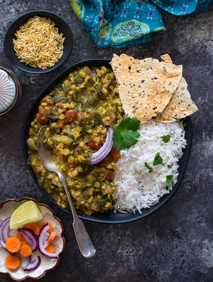 Moringa dal served with rice and papad