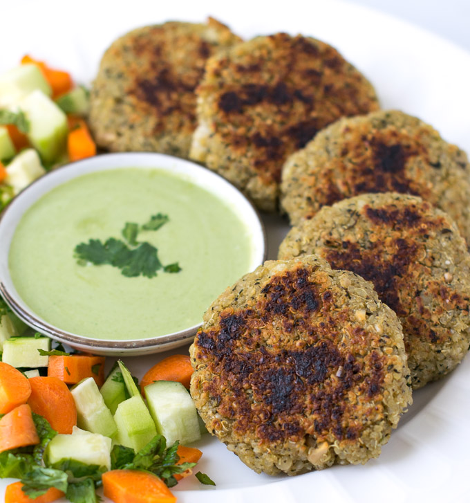 Quinoa paneer cutlets with green dip and salad served together.
