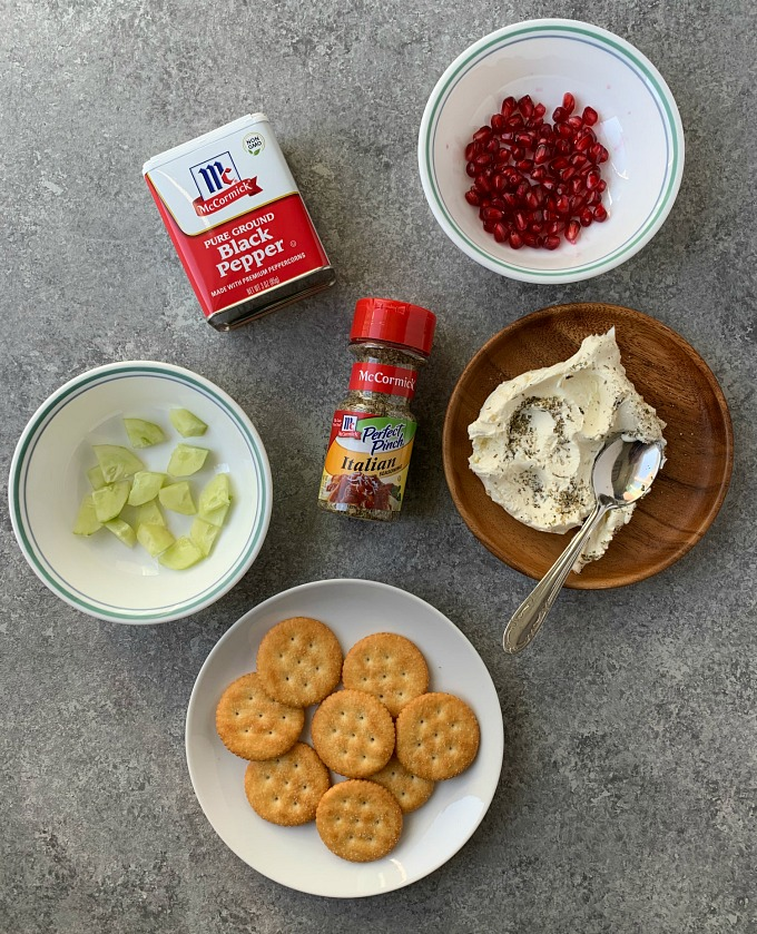 Ingredients for herbed cucumber cream cheese crackers