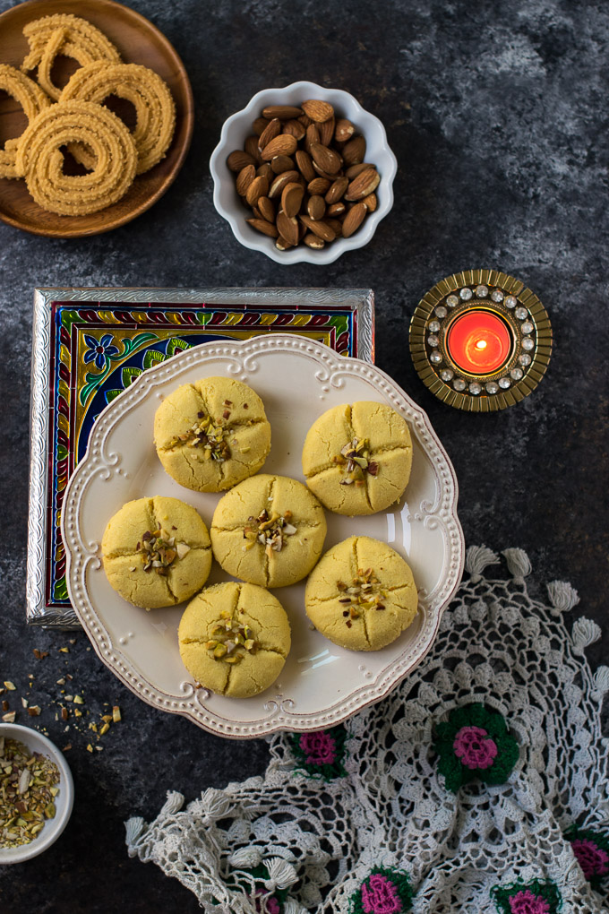 Nankhatai on a platter alongside chaklis & almonds