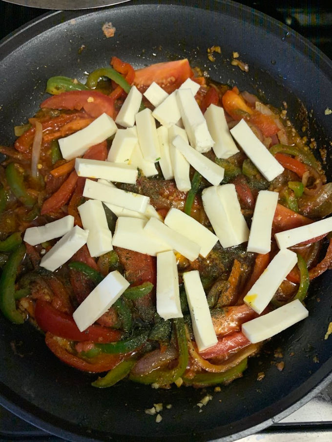 Paneer added to the pan with veggies