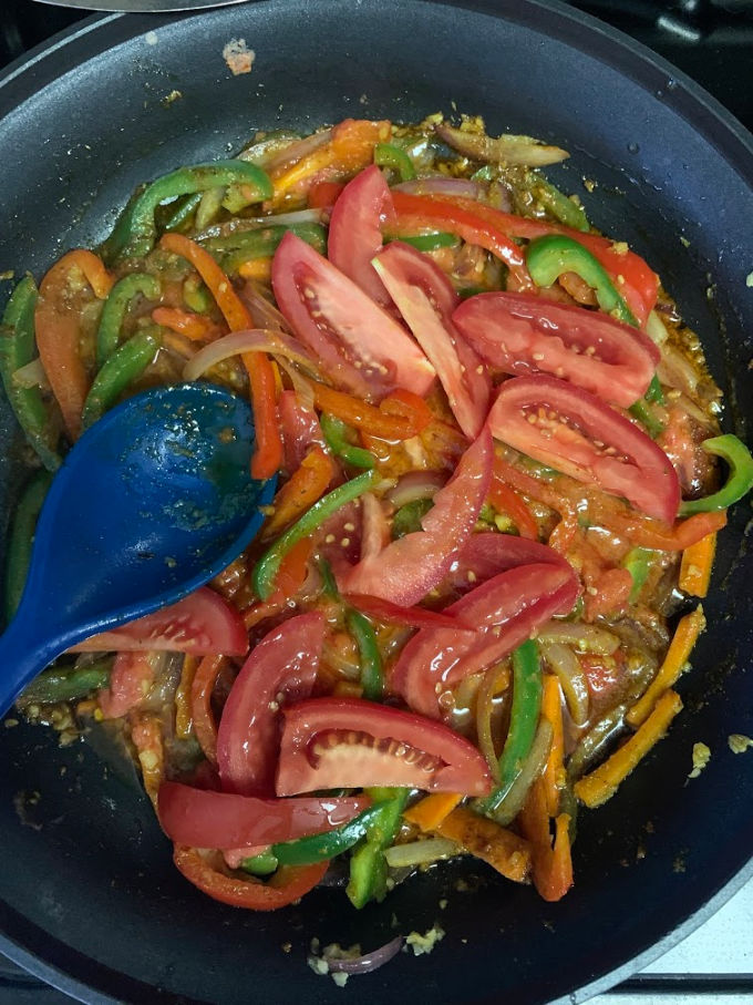 Next step tomatoes added to the pan