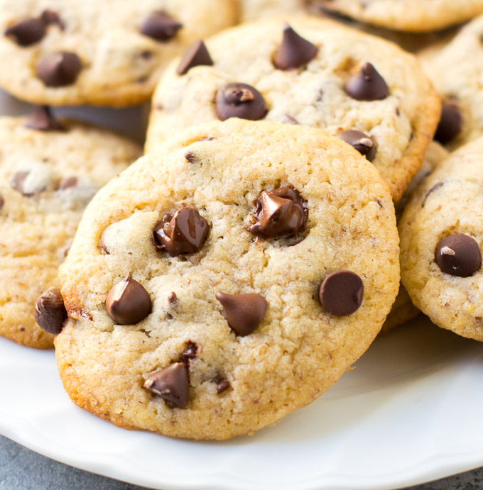 Eggless Chocolate chip cookies served on a white plate.