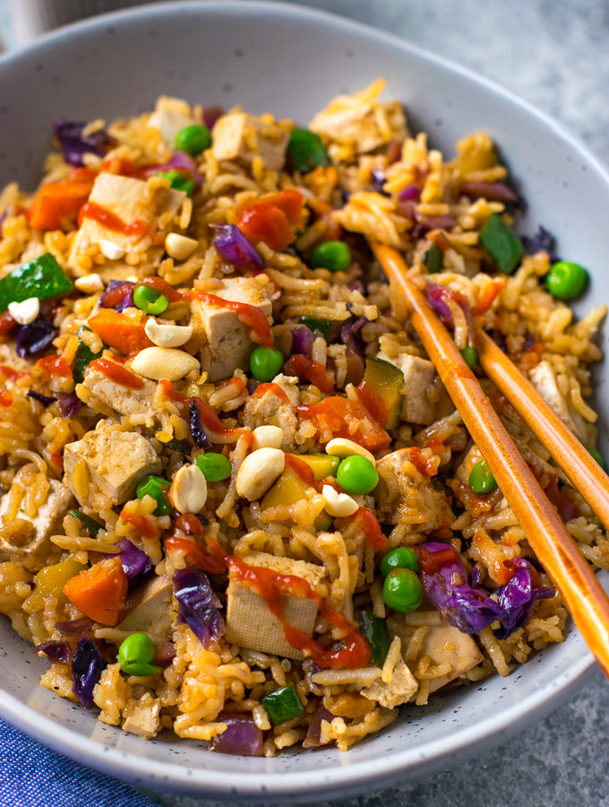 Fried rice with vegetables and tofu served in a bowl