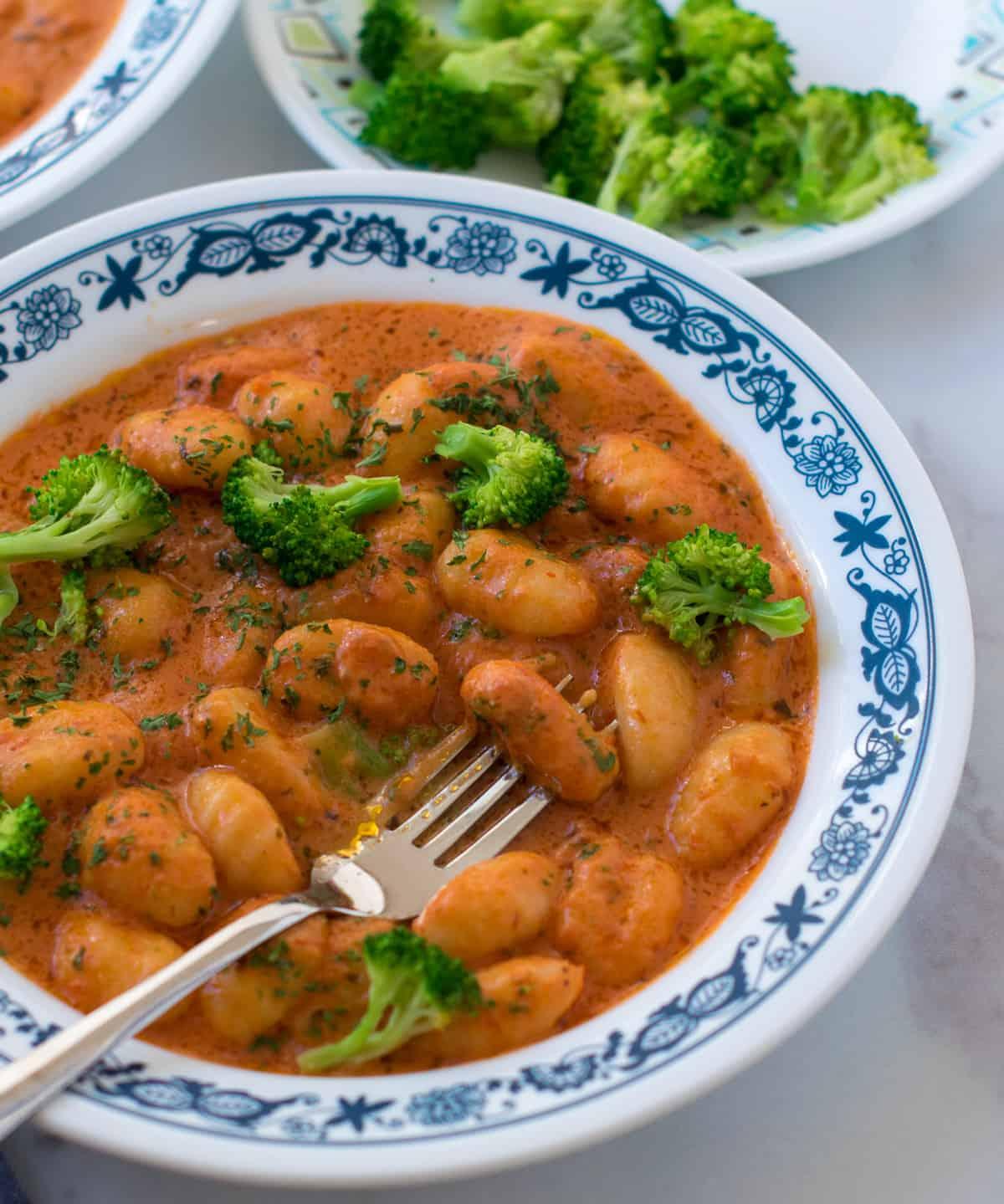 Delallo gnocchi tossed in creamy tomato sauce and broccoli