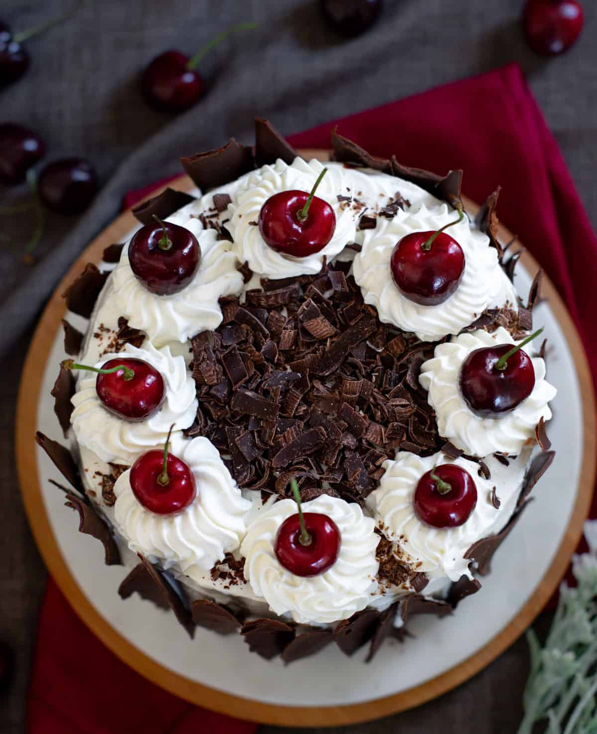 Eggless black forest cake served on dish with a red napkin