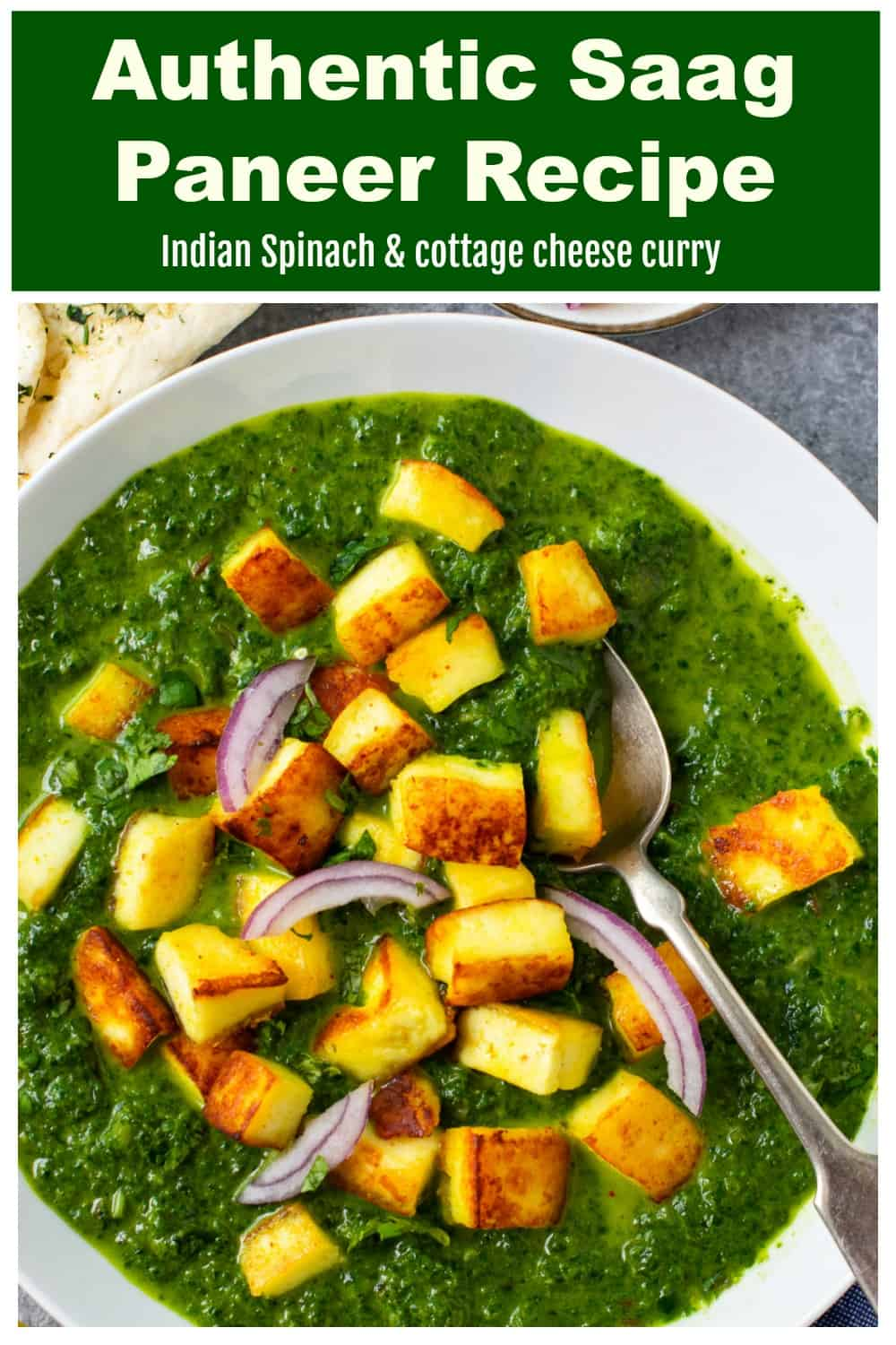 Indian spinach and cottage cheese curry in a white bowl