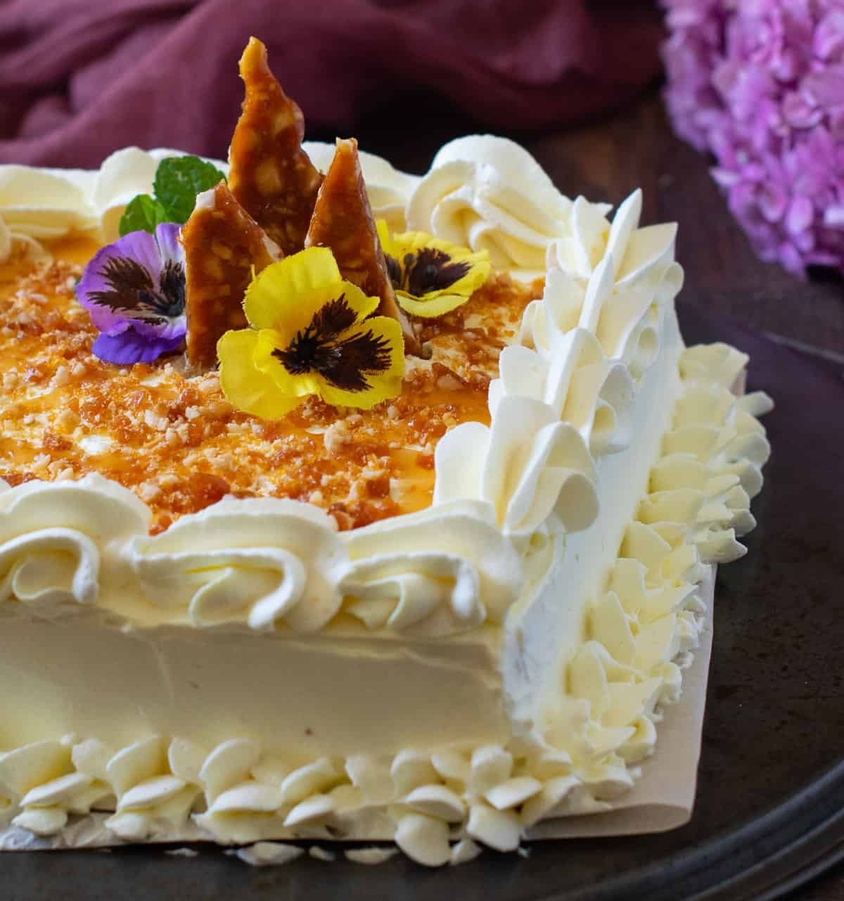 Whipped cream frosted butterscotch cake with decorations
