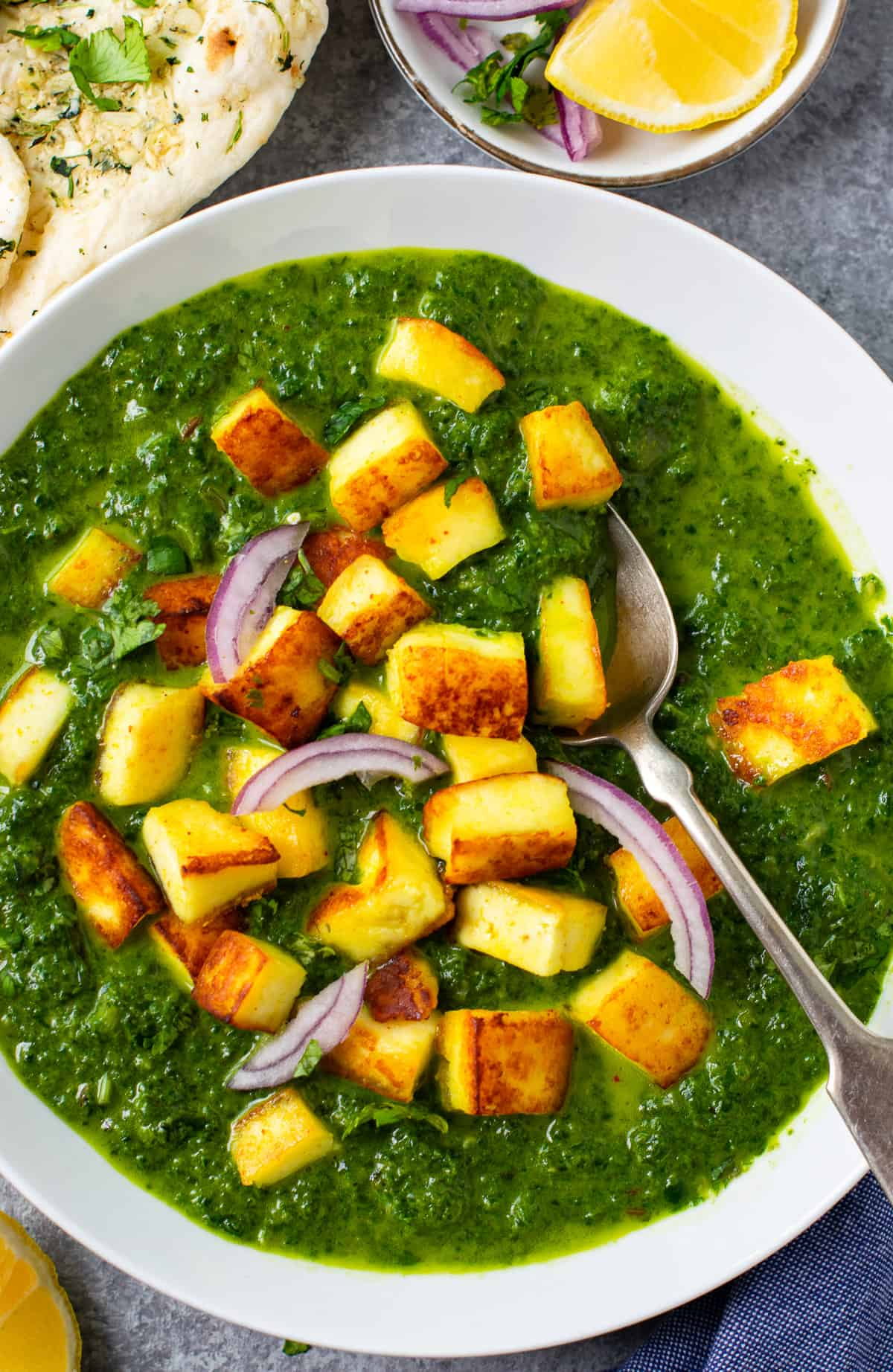 Spinach saag topped with paneer and sliced onions