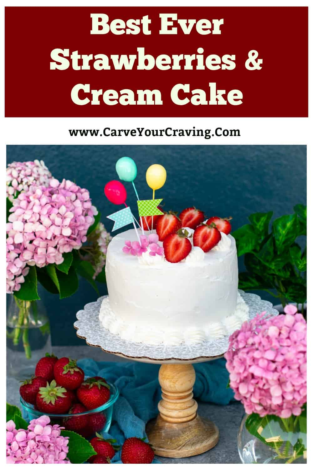 White cake with strawberries on a cake stand