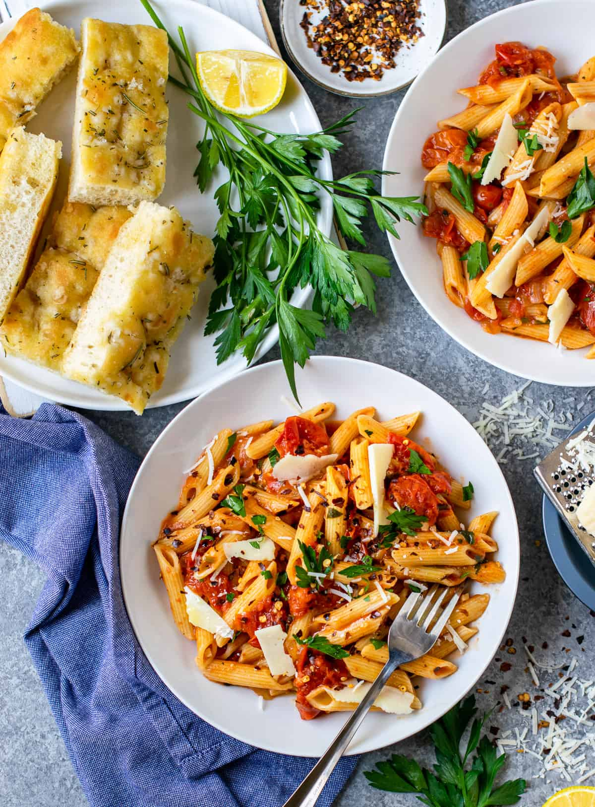 Penne pasta served with foccasia bread on the side.