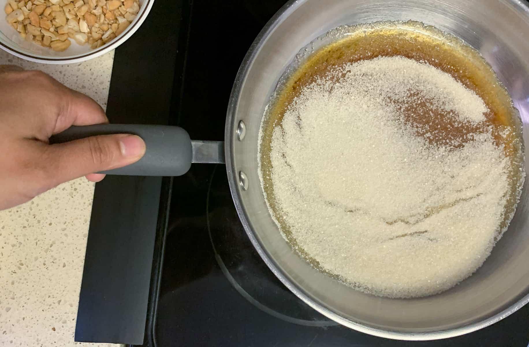 Swirling the pan with sugar