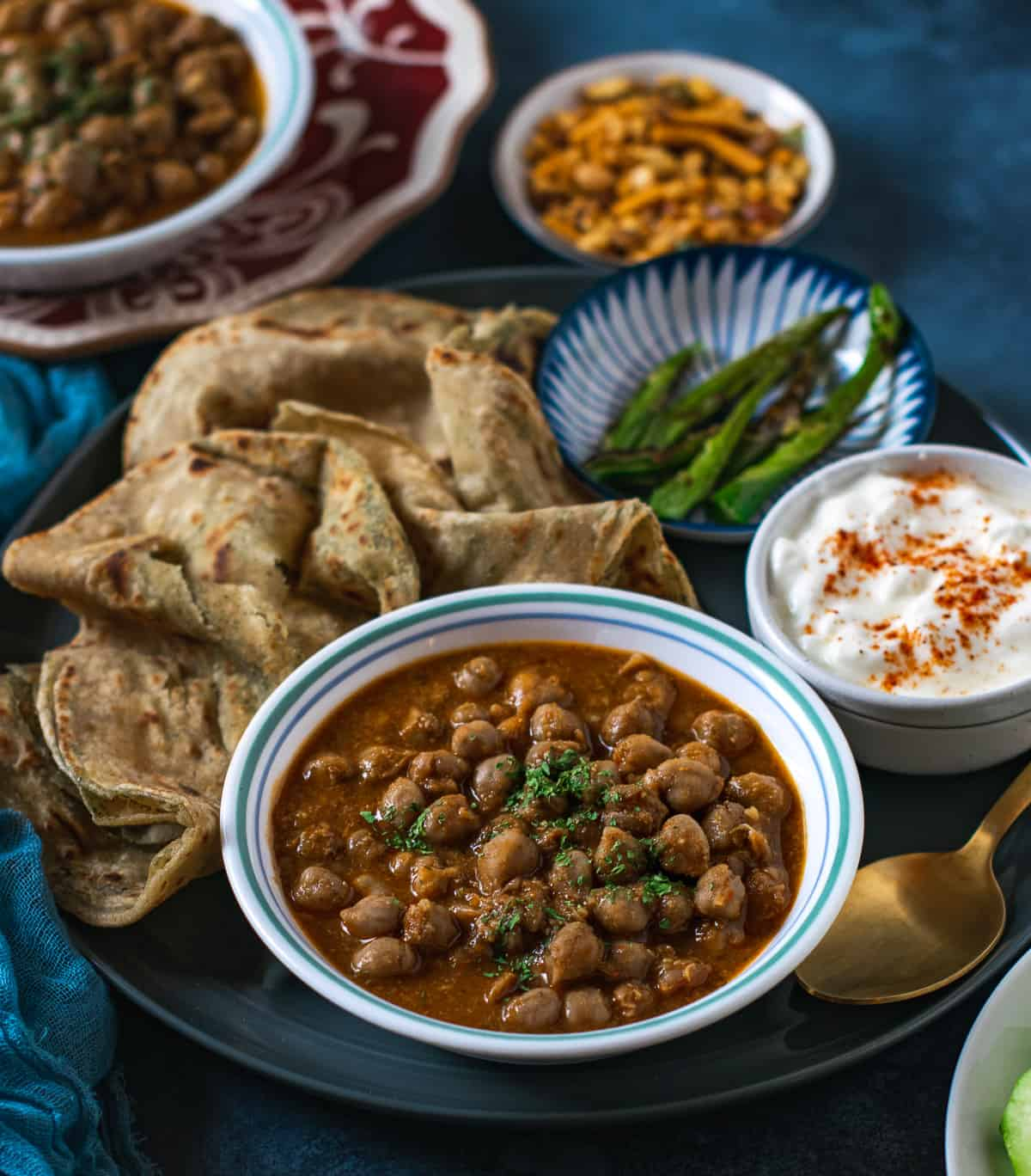 Punjabi brown chole servedwith yogurt