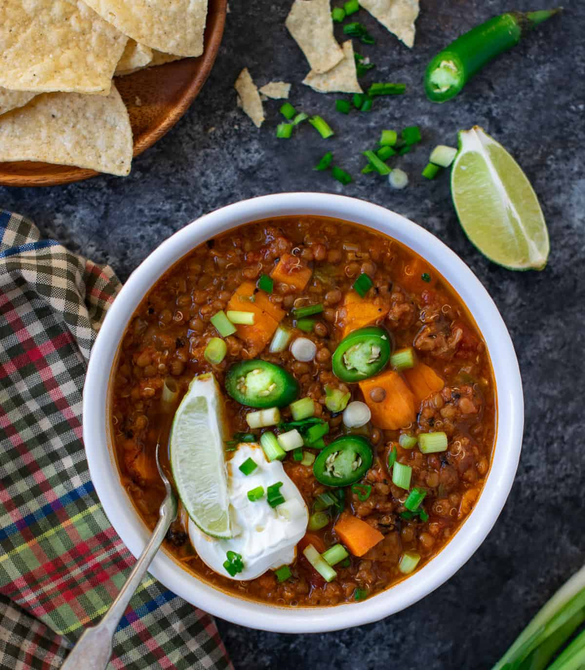 Sweet Potato quinoa lentil chili served with sour cream and lemon on the top