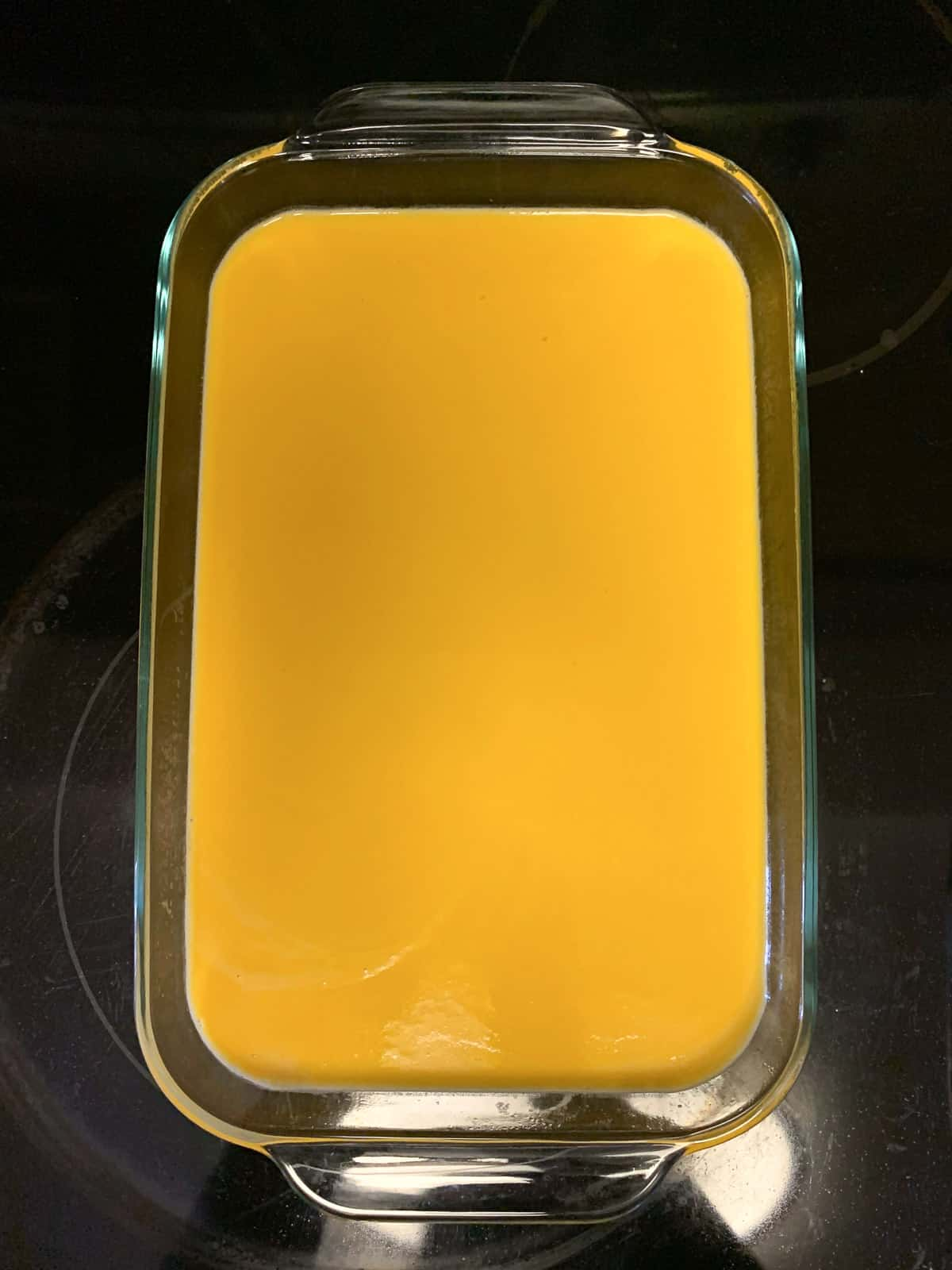 Setting Mango Panna Cotta in a glass pan