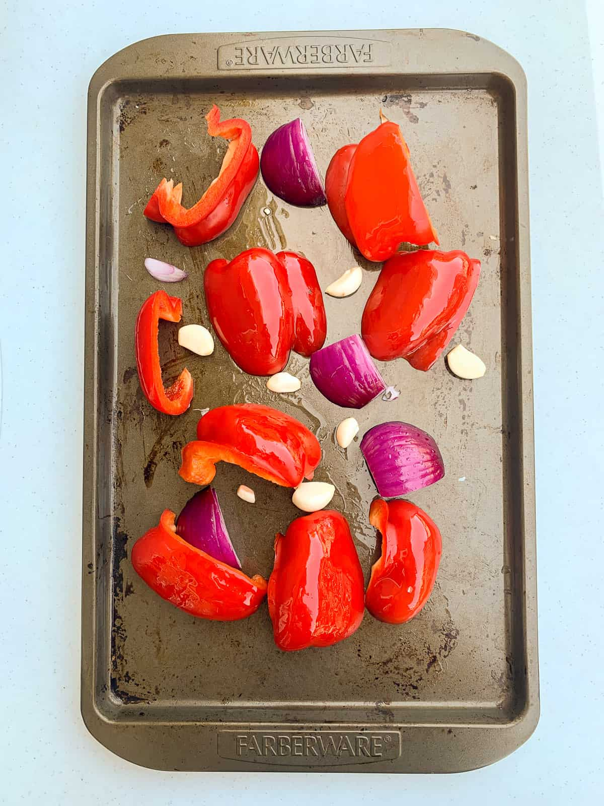 Veggies set on a baking tray for roasting