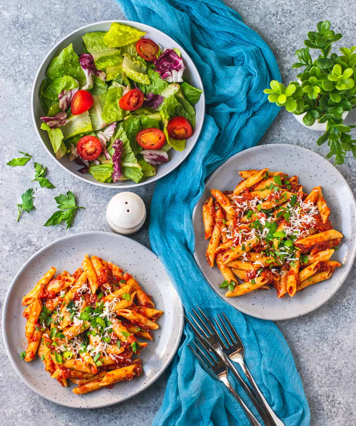 Vegan pasta served with salad on the side