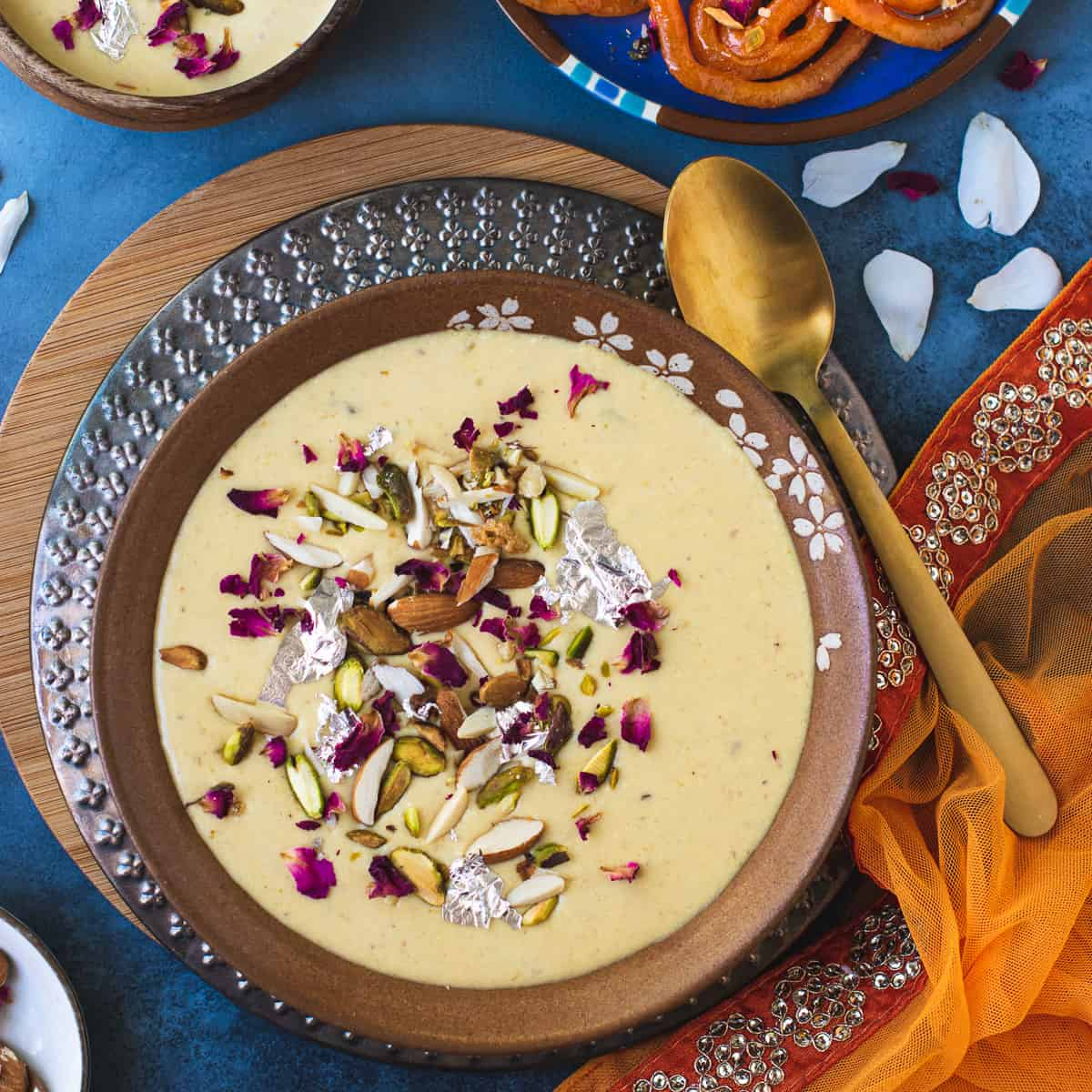 Instant Rabdi served with nuts and rose petals on top
