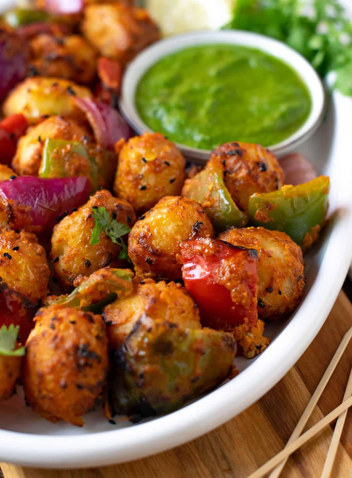 Tandoori potatoes served in a white plate