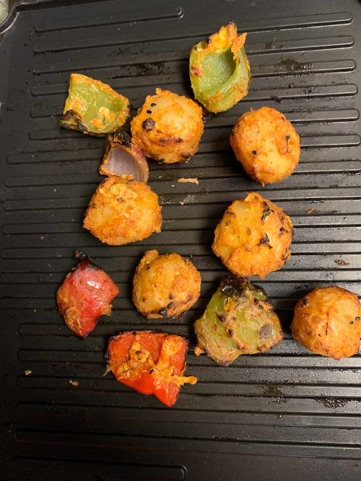 Grilling potatoes and peppers