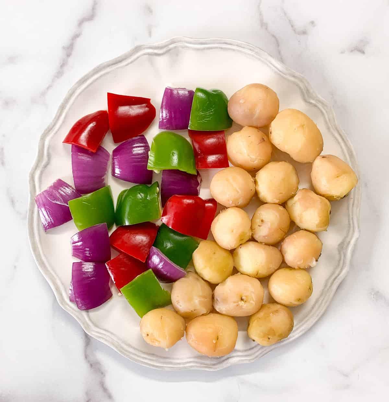 Ingredients to make achari aloo tikka