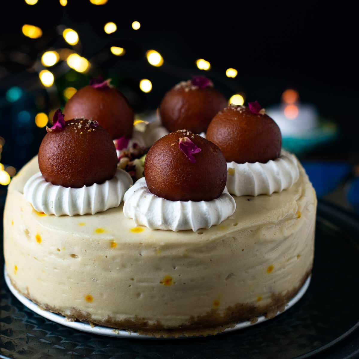 Indian cheesecake with diwali bokeh lights on the back