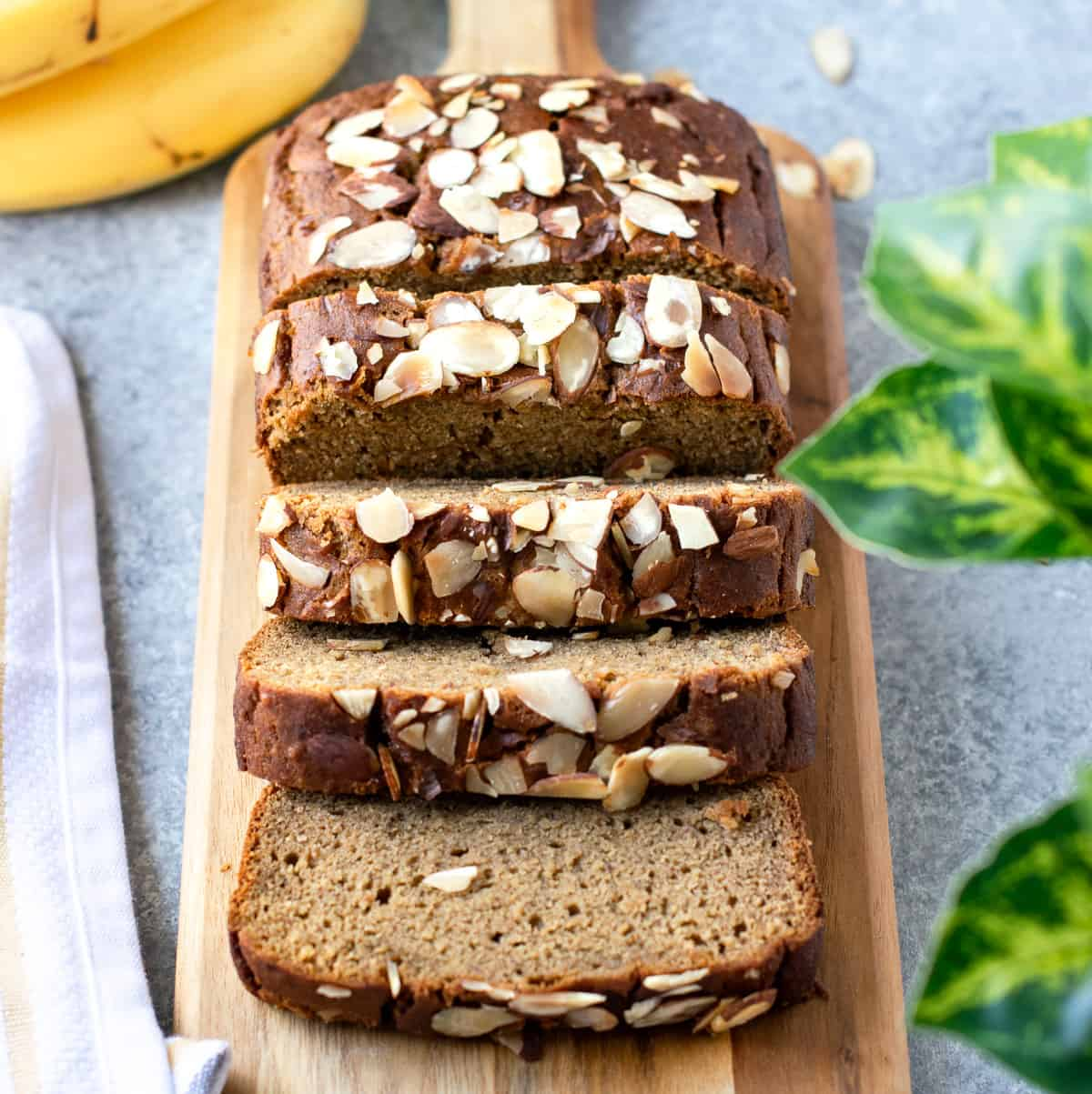 Banana bread with almonds on the top of the bread.