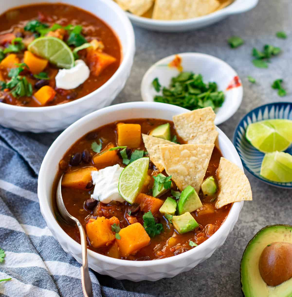 Butternut Squash Black Bean Chili derved with sour cream and chips