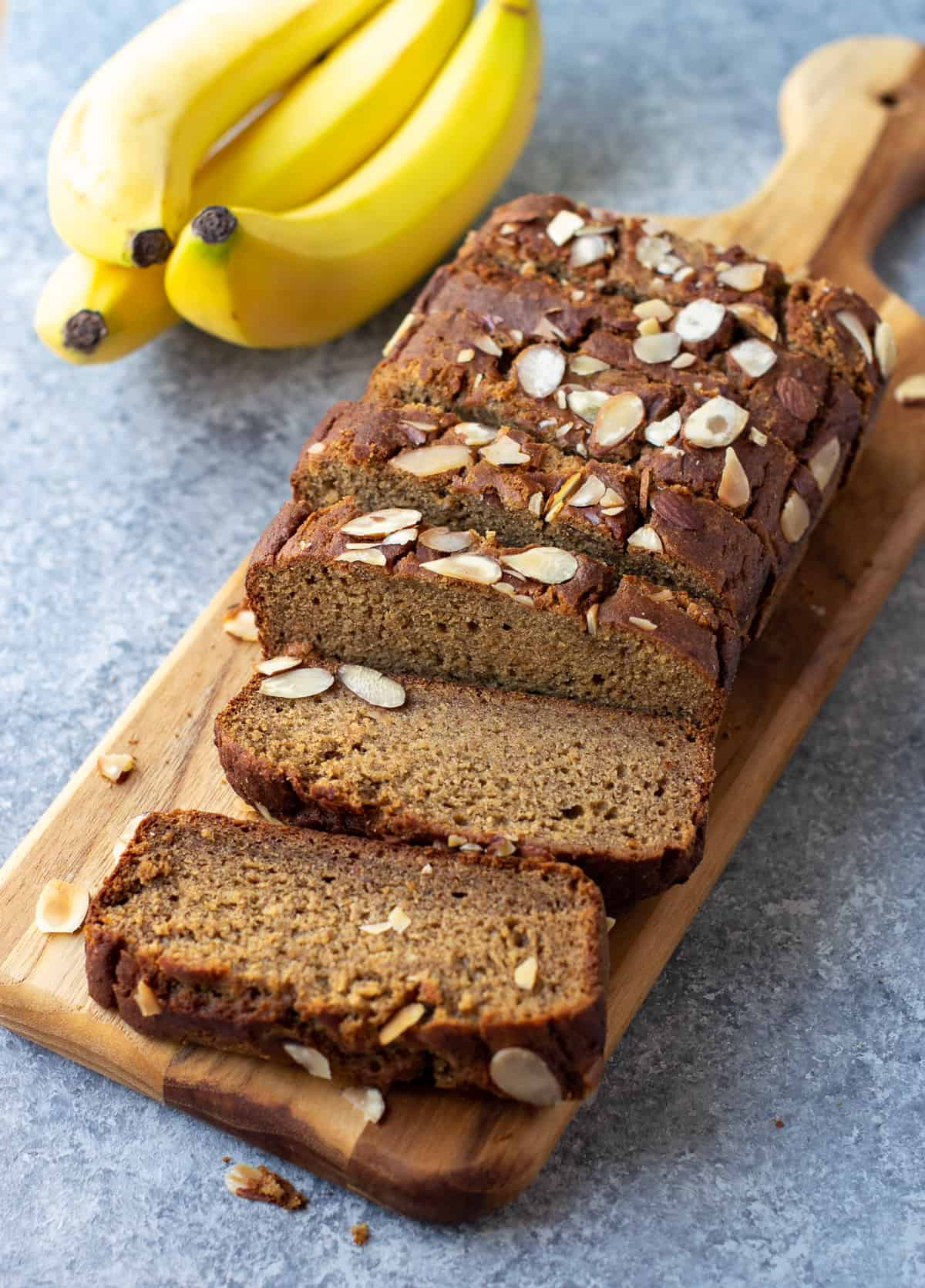 Healthy eggless banana bread ready to serve on a cutting board