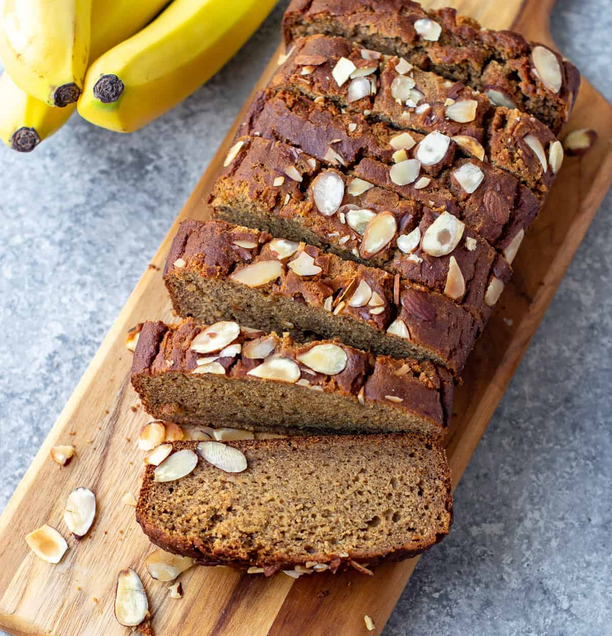 Eggless banana bread with bananas on the side