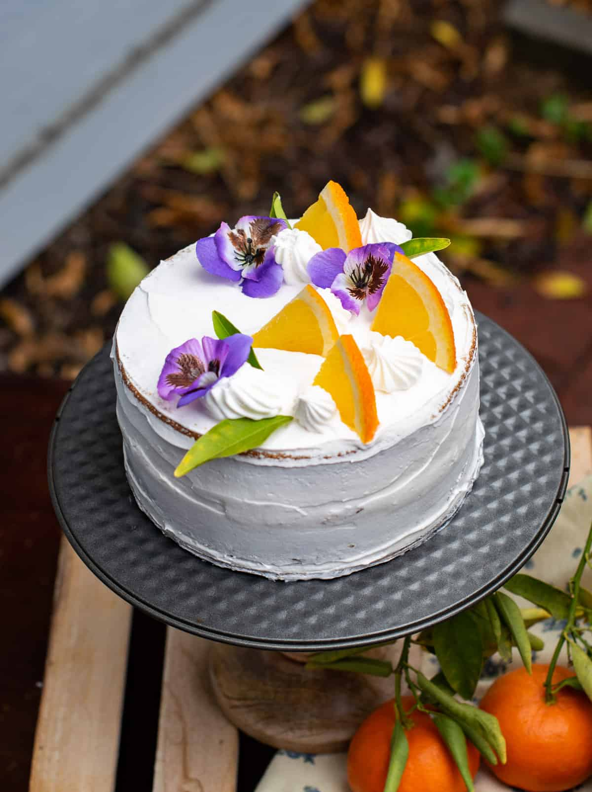 Frosted orange cake decorated with flowers