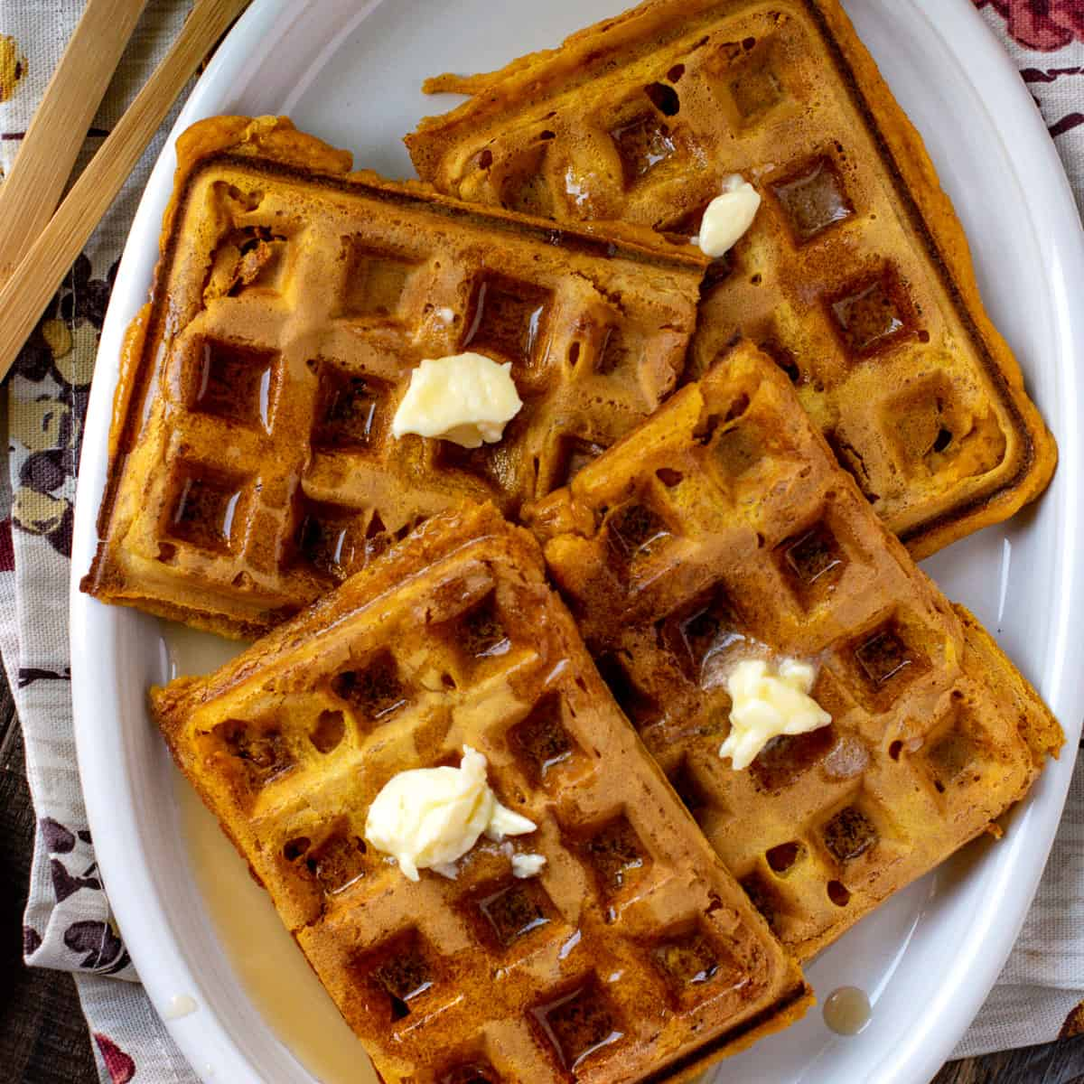 Eggless pumpking waffles on a white platter
