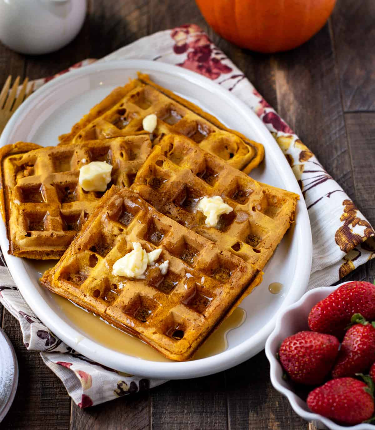 Breakfast pumpkin waffles with maple and melted butter