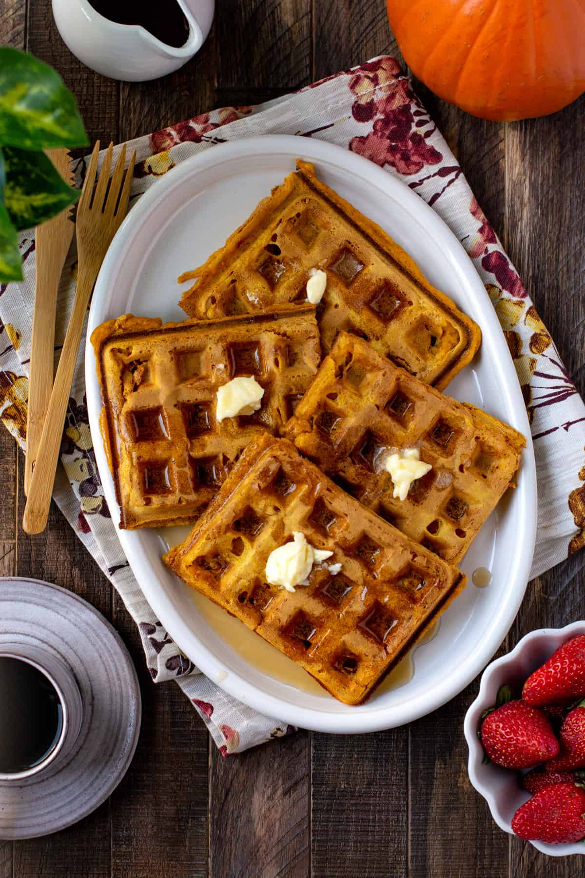 Vegan Pumpkin Waffles served in a white platter with coffee