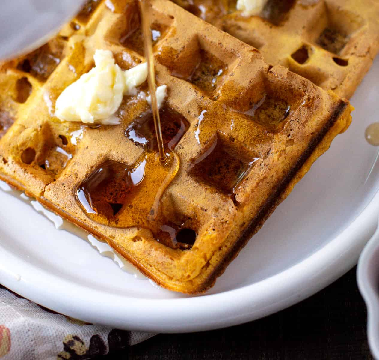 Vegan Spiced Pumpkin Waffles with maple syrup and butter