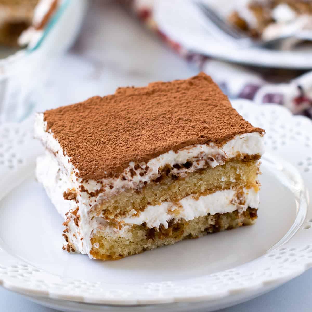 Eggless tiramisu cake on a white plate