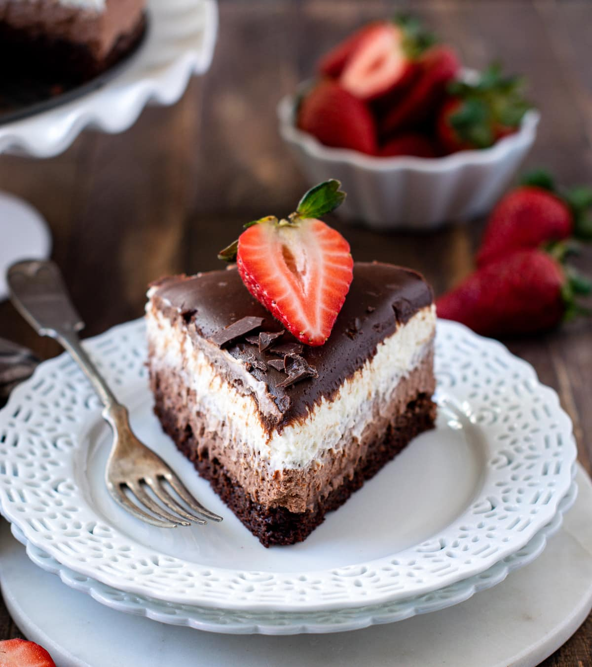 Triple Chocolate mousse cake with a fork on the side
