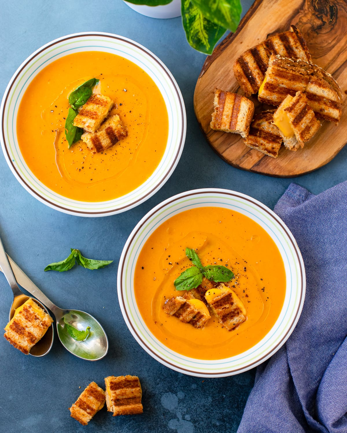 Hearty Oatmeal Vegetable Soup bowls served with grilled cheese