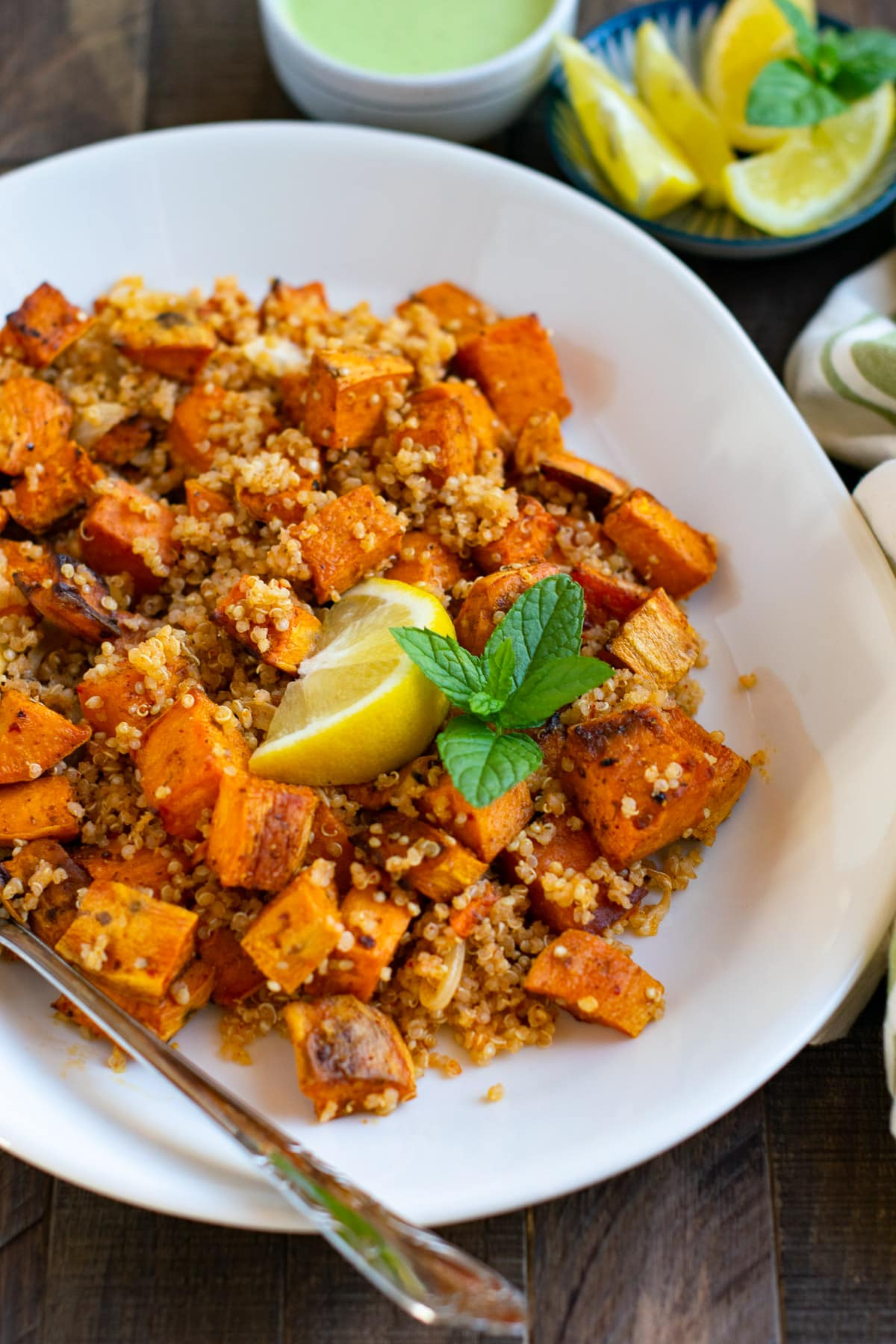 Quinoa and sweet potato salad in a white plate