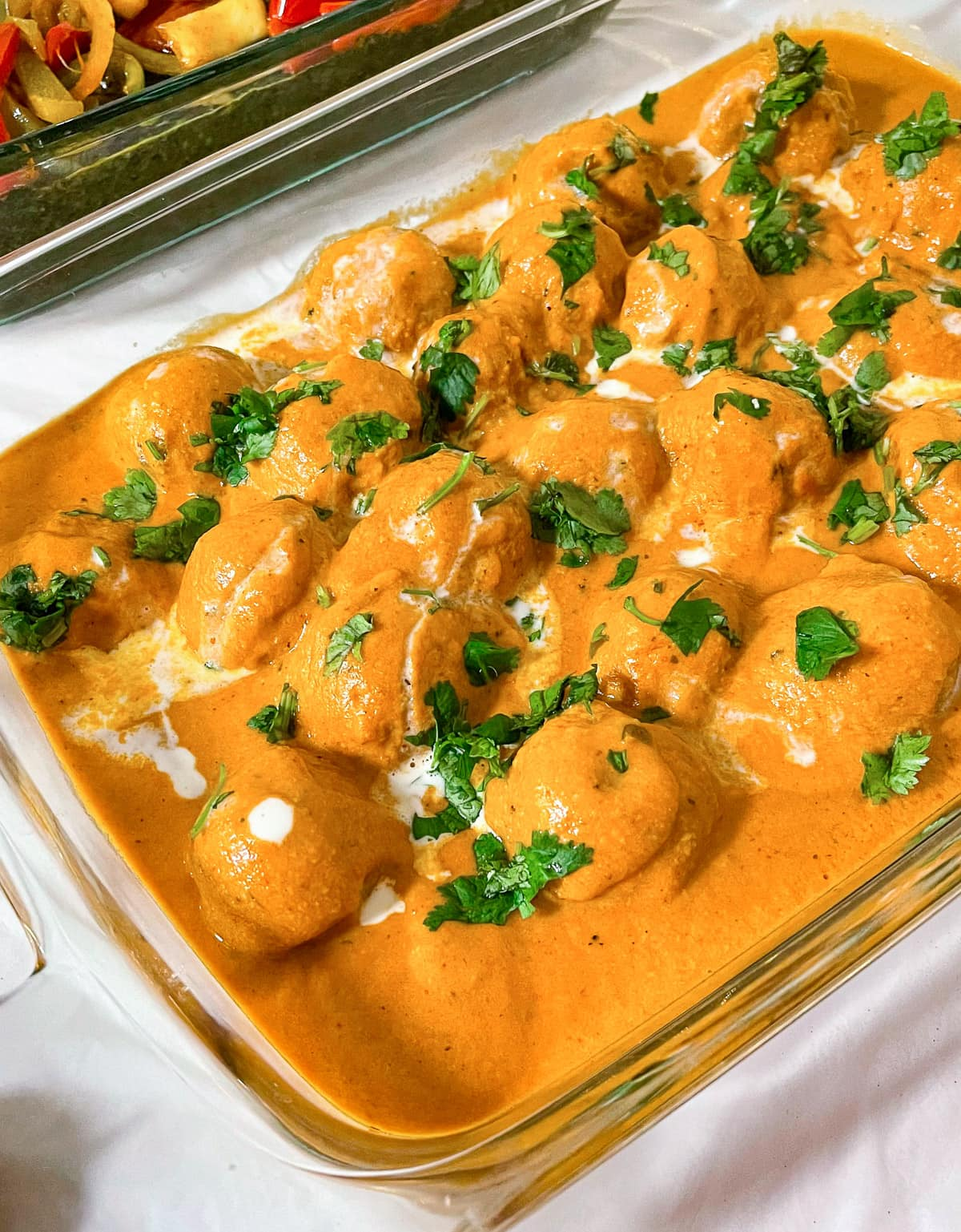 Large quantities of Malai Kofta in a catering tray
