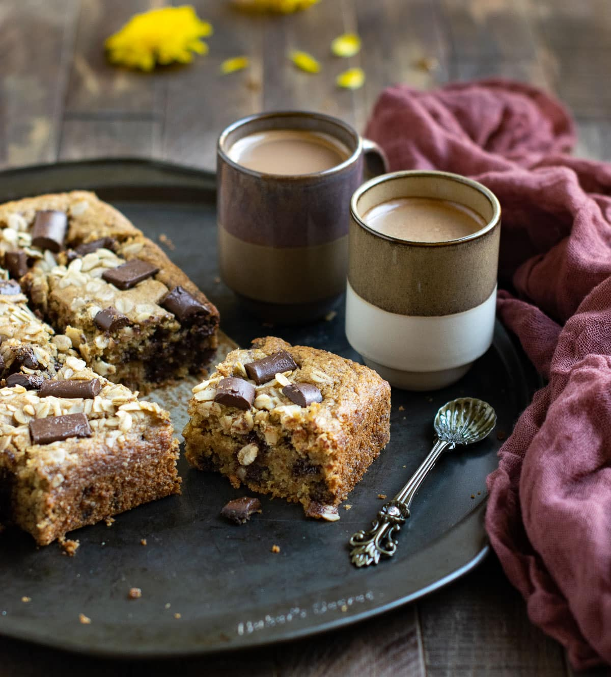 Banana Oatmeal Cake pieces served with coffee and spoon