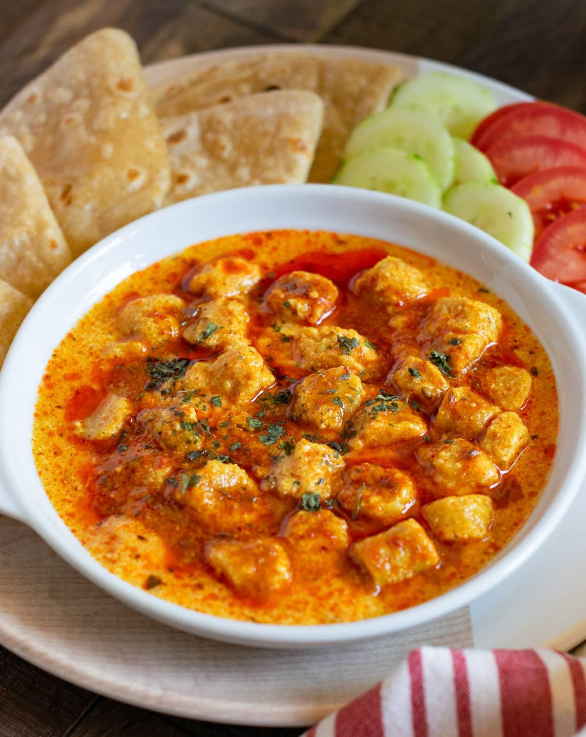 jain besan gatte ki sabji served in a white bowl