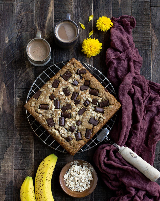 Almond banana oatmeal cake on a cooling rack